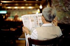 Newspaper (dtanist) Tags: street new york city nyc newyorkcity hk newyork film brooklyn analog sushi table 50mm reading restaurant newspaper cafe ar tea kodak diner indoors 100 konica t3 bensonhurst autoreflex ektar 86th hexanon