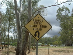 Reduce Speed - Sharp Bend Ahead (RS 1990) Tags: park old trees signs strange bike bmx december traffic unique australia age worn adelaide weathered 2008 southaustralia teatreegully ridgehaven ashleyave ovalave