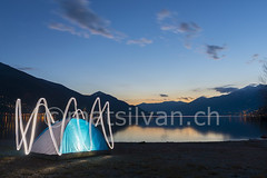 Tent (Mats Silvan) Tags: longexposure blue camping light sunset sea sky mountain lake lightpainting alps color reflection beach nature water clouds sunrise painting outside switzerland ascona ticino technology wave nobody tent illuminated snowcapped lighttrails bluehour alpinelake lakefront lull lagomaggiore swissalps mountainrange lepontine vision:sunset=0732 vision:mountain=0624 vision:outdoor=099 vision:clouds=0954 vision:sky=099 vision:ocean=0501