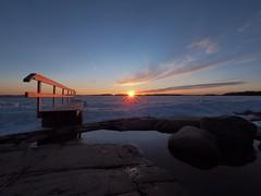 Sunburst (Jarno Nurminen) Tags: shore winter seascape finland helsinki lauttasaari mzuiko 714mmf28pro sunset pier