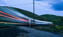 goecken road crossing (pbo31) Tags: livermore eastbay alamedacounty country color april 2017 spring boury pbo31 nikon d810 sky bayarea lightstream motion ace train altamontcorridorexpress commuter motionblur blue rail green altamontpass powerlines crossing curve over turbines windfarm power energy earth