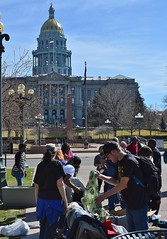 Looking through the clothes at a free giveaway in downtown Denver, sponsored by two area churches. The Inspire Church and Refuge Church host the event once a month at Civic Center Park. (desrowVISUALS.com) Tags: poverty poorpeople austerity capitoldome coloradostatecapitol capitol hardtimes charity needy service capitolbuilding coloradostatecapitolbuilding freeclothing clothinggivaway theinspirechurch therefugechurch