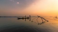 """Sailing by the setting sun"" (Sudeep Nandi) Tags: fisherman boat goldenhour riverbanks brahmaputra wideangle fishingnet waterscape beautifullandscape ambientlight water boatman sunset sky"