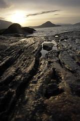 Coastline (Thai Font Issue) Tags: sunset warm autumn norway shore rock landscape