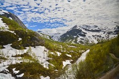 View out of Flam railway (SamWJL) Tags: railway flam river mountains greenery summer blue sky norway majestic nature natural snow peak