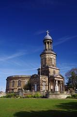 Stand clear (Sundornvic) Tags: church shrewsbury shropshire stchads town centre quarry park grass trees blue sky clouds light tower cross