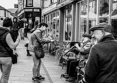 Singing to the Clarinet player. (steve.gombocz) Tags: blacknwhite greyscale streetscene blackwhite bwphotos bw bwstreet flickrbw bwflickr blackwhitephotos flickestreet blackwhitestreet streetlife street blackandwhite streetphotographs bwphotographs streetbw streetphotography bwpictures flickraddicts blackandwhitephotographs outandabout streetpictures flickr exploreflickr olympus streetmusic streetentertainment streetbusker busker busking music clarinet keswick explorekeswick keswickbw olympususers olympusm25mmf18 olympusem5mark2 olympuszuikodigitalclub olympuseurope zwartwit neroebianco sortoghvid mustavalkoinen svarthvitt svartoghvitt svartochvitt pretoebranco noiretblanc schwarzundweiss negroyblanco noirblanc schwarzweiss negroblanco pretobranco nerobianco