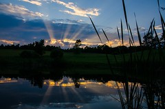 Sunset Rays (Sunset Master) Tags: reflections sunset sun rays blue yellow field vermont nikon pond sky nature peaceful clouds landscape water