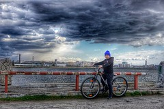 Facing the storm with my nephew (andrei comsa) Tags: nephew storm lake city cityscape urban bycicle sony a6000