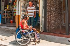Wheelchair Man (fotofrysk) Tags: man wheelchair shops shopkeeper sanjosearenalroute calle1 centralamericatrip costa rica sanramon sigma1750mmf28exdcoxhsm nikond7100 201702069375