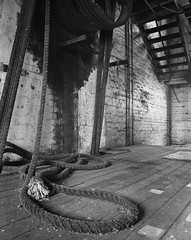 Driveshaft rope Harts Mill (mernamora) Tags: derelict hartsmill flour mill analogue bw monochrome old antique machines machinery discover patent