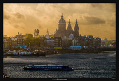 Amsterdam Sunset (Ilan Shacham) Tags: amsterdam netherlands holland city urban fineart fineartphotography cityscape landscape view sunset canal river boat church kerk steeple sky clouds dramatic drama