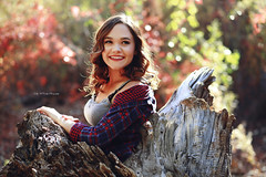 Amanda (Kelly McCarthy Photography) Tags: woman autumn portrait portraiture smile backlight backlit catchycolorsred forest woods outdoors plaid tree seniorportrait bokeh naturallight expression expressive