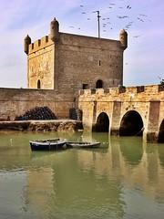 Essaouira Port Reflection (zorro1945) Tags: africa reflection tower water birds architecture port boats northafrica arches morocco maroc ramparts essaouira