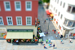 small cafe (Tomsch) Tags: street people linz austria cafe strasse menschen landstrasse tiltshift kaffeehaus tiltshiftfake osterreich tiltshiftmaker