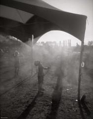 Shadows In the Mist (BunnySafari) Tags: bw music film holga musicfestival ilford3200 fpp guelphlake autaut hillsidefestival2013 developedintmaxfor85min fixedfor6minutes spritztent