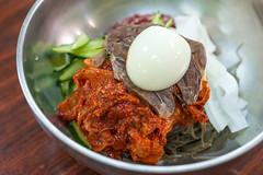 Chilled Spicy Buckwheat Noodles with Raw Fish -  Go Hyang Jib Korean Restaurant (Michael Shum) Tags: food restaurant korean noodle zeissmakroplanart250zf2 gohyangjibkoreanrestaurant