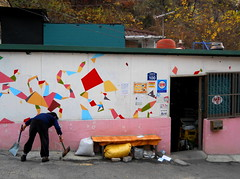 "Seoul Korea slum ant village colorfully adorned retro supermarket on hillside - ""Old-school"" (moreska) Tags: travel autumn decorations tourism bars asia doors village ant working murals cleanup korea supermarket oldschool retro forgotten seoul signage bodega 1970s renovation isolated slum neighborhoods rok shantytown hangul sweeping momandpop greengrocer revitalization"