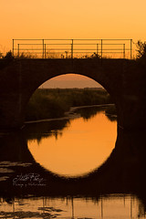 Reflejo circular (Tito Paez) Tags: road bridge sunset sky orange reflection brick ladrillo water argentina field grass silhouette clouds ro rural creek canon river circle landscape puente atardecer golden ancient