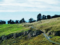 The Port Hills (Steve Taylor (Photography)) Tags: road trees newzealand christchurch grass car silhouette rock canterbury nz summit southisland rd porthills