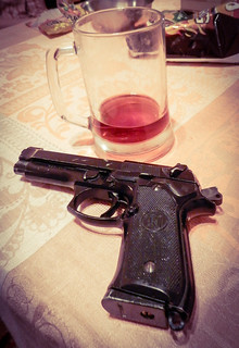 From http://www.flickr.com/photos/37441499@N07/12248801663/: Gun and alcohol
