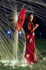 Burning Rain 01 (FoxyChan81) Tags: red woman rain night stars japanese fireworks no burning parasol geisha shooting kimono sparks hanabi josei