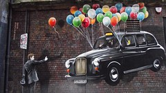 hailing a cab (byronv2) Tags: streetart man building architecture painting balloons graffiti scotland mural glasgow cab taxi taxicab hackneycab mitchellstreet