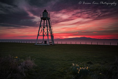 Silloth Sunset (.Brian Kerr Photography.) Tags: silloth cumbria solway dumfriesandgalloway sunset lighthouse sky colours daffodils flowers solwayfirth outdoor outdoorphotography appicoftheweek wexmondays sony a7rii availablelight natural nature