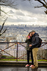 At the Viewpoint of the Sacre-Coeur (PabloLopezPhotography.com) Tags: basilica paris france sacre coeur sacred heart black white blackandwhite roman catholic church minor landmark popular summit butte montmartre highest monument penance defeat franco prussian war commune socialist neighborhood conservative moral order jesus vision loving sympathetic christ paul abadie consecrated pablo lopez pablolopez streetphotography street old man rosary beads stairs steps entrance exit viewpoint landscape couple phone selfie colored coloured girl boy woman
