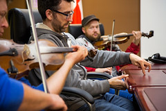 Ian MacDougall, from left, Mac Morin and Fergal Scahill (We Banjo 3) rehearse backstage. (photo: Steve Wadden)