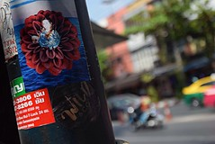 Wild & Co. - Bangkok (jcbkk1956) Tags: flower taxi dof 1870mmf3556 nikkor d3300 nikon thailand thonglo traffic bangkok streetfurniture post street graffiti stickers blur worldtrekker