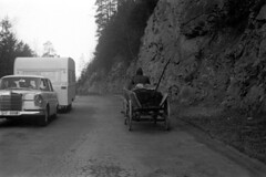04a2671 13 (ndpa / s. lundeen, archivist) Tags: nick dewolf nickdewolf bw blackwhite photographbynickdewolf film monochrome blackandwhite april 1971 1970s 35mm austria austrian tyroleanalps tyrol tirol alps mountains mountainpass pass reschenpass roadtrip ontheroad lechtalalps passodiresia road highway alpine car vehicle automobile trailer mercedes mercedesbenz horsedrawn cart wagon people man driver