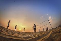 Play Time... (aestheticsguy2004) Tags: neeteshphotography 8mm fisheyelens beachplay nikon nikonindia marinabeach chennaimarina tamilnadubeach india travelindia volleyball game sunrise sunshine chennai sand glowinsand