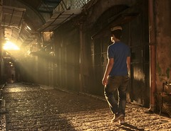 Jester of Jerusalem (David Mor) Tags: jerusalem oldcity alley alleyway sunrise jester light streetphotography balance balancingonhead mind things
