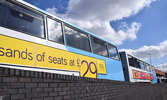 Thousands of seats - advert on the side of a National Express Coventry bus (paulburr73) Tags: nxc coventry buses notinservice lineup dennis trident doubledeckers wt cv wheatleystreet garage depot sundayafternoon april spring sun sunny 2017 nationalexpress advert westmidlands midlands bus sky sunshine