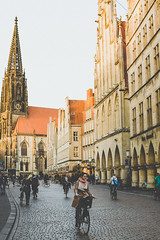 Münster love (neus_oliver) Tags: sunset city europe germany münster bike rider ride church townscape cityscape architecture street streetphotography candid sun woman