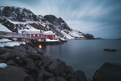 The little secret behind Nusfjord (Sunny Herzinger) Tags: norway night fujixpro2 cottage winter norge lofoten fjord red xf14mmf28 clouds nusfjord nordland no visipix