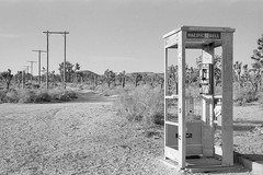 mojave phone booth. cima, ca. 2000. (eyetwist) Tags: eyetwistkevinballuff eyetwist mojavephonebooth mojavedesert mojave desert pay phone booth telephone longdistance famous landmark california nikon fa nikkor 50mm kodak trix tx tx400 bw black white nikonfa nikkor50mmf14ais kodaktrix400 scansfromthearchives ishootfilm ishootkodak blackwhite monochrome film emulsion grain analog analogue 35mm joshuatrees american west americana historic landscape 7607339969 payphone cima tbt phonebooth fabled mystery legend gone collectcall