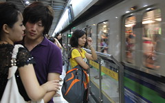 Mixed Emotions Metro Platform Shanghai City China Asia (eriagn) Tags: people student woman man waiting metro platform train speed commuters transport rail blur affection yellow orange purple clothing tired weary love shanghai city china asia dailylife ngairelawson ngairehart eriagn documentary travel photography 上海市 emotions feelings streetshot buildings social town global colourful candid canon eos red blue everydaylife