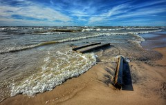 Brought in by the Waves (mswan777) Tags: shore sand waves water seascape lake michigan driftwood dock scenic landscape stevensville nikon d5100 sigma 1020mm cloud sky shoreline nature outdoor