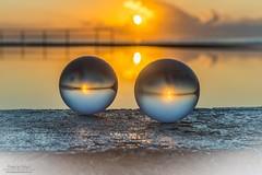 Twin thoughts of morning (Rakuli) Tags: ifttt 500px sunrise water sun clouds ocean gold golden glass still balls refelction