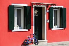 Bicycle (Bianchi David) Tags: italia murano burano venezia venice italy bicicletta bycicle red rosso muro casa canale canal window finestra porta vivid color multicolor