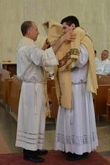 Fr. Schreiber vests Deacon McElrath