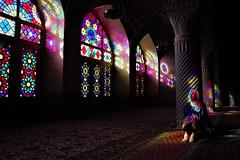 Girl in the Light (rikbuitenwerf) Tags: shiraz mosque glass girl woman iran masjed masjede nasir nasiralmolk stainted raam reflection colours kleuren loft ali khan