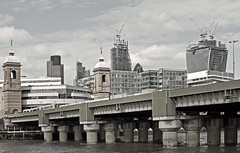 Canon Street Rail Bridge & City View (Canon 500D & Samyang 35mm F1.4) (markdbaynham) Tags: street city uk bridge urban london tower heron thames skyline cheese 35mm canon river square lens eos f14 capital rail gb metropolis dslr grater mile natwest samyang apsc