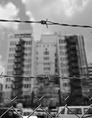 DSC_4847 (rob dunalewicz) Tags: atlanta blackandwhite facade fence downtown barbedwire gulch 2013