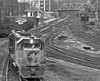 Grafton, West Virginia, with a GP35 and GP9 in the foreground, a train awaiting departure in the background, and a Shessie System loco near the old coal dock. 1976 (Ivan S. Abrams) Tags: blackandwhite newcastle pittsburgh butler bo ge prr ble conrail alco milw emd ple 2102 chessiesystem westmorelandcounty 4070 bessemerandlakeerie steamtours pittsburghandlakeerie ivansabrams eidenau steamlocomtives ustrainsfromthe1960sand1970s