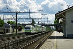 Finnish Railways Class Sr2 electric loco No. 3241 speeds through Hyvink on 2 July 2013 (A Scotson) Tags: station electric finland swiss railway trains locomotive vr hyvink marsu sr2 valtionrautatiet finnishstaterailways hyvinkasema