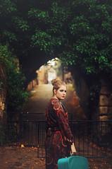 Lucy VII (Ella Ruth) Tags: street portrait woman girl fashion vintage 50mm photographer dress path 14 naturallight retro shrewsbury redlips femalemodel archway suitcase englishtown patterned updo hairup bluesuitcase nikond90 ellaruth