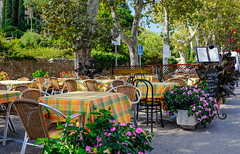 Early morning at Pizzeria Vesubio, Valldemossa (Gene Krasko Photography) Tags: morning flowers trees fall colors cafe spain chairs espana tables tablecloth pizzeria leafs mallorca majorca valldemossa ves